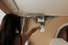 Close-up Of A Shocked Woman Looking At Mold
